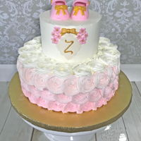 Rosette Baby Shower Cake Rosettes on the bottom tier. Fondant/tylose baby shoes.