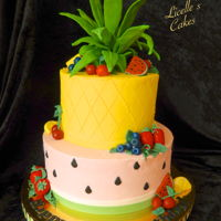 Tutti Frutti Cake buttercream cake with handmade fondant fruit and pineapple top ( supported on wires)
