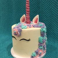 Unicorn Cake My first unicorn cake! Turned out more beautiful than I could have dreamed! Had issues with back flowers falling off .... but live an learn...