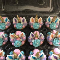 Unicorn Cupcakes Unicorn cupcakes! I made 30 cupcakes, half strawberry and half were vanilla with rainbow sprinkles inside. The horns were cotton candy...