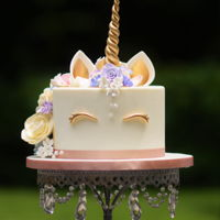 Unicorn Elegance A unicorn cake with a a mane of sugar flowers!!
