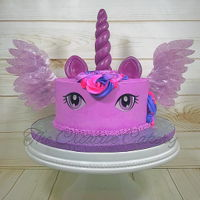 Unicorn Pegasus My first attempt at a unicorn/pegasus cake. I used rice paper for the winds, candy clay for the horn and ears, and frosting sheets for the...