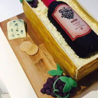Wine Crate Cake Layers of vanilla cake covered in fondant crate sides, with edible wine bottle, cheese, crackers and grapes