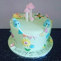 Craft Garden Cake Pastel coloured cake with stitch detailing and bunting