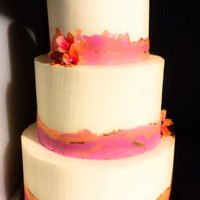 Watercolor Buttercream Cake With Sugar Flower Accents A sunset inspired watercolor buttercream cake finished in three tiers with small sugar flowers and gold highlights