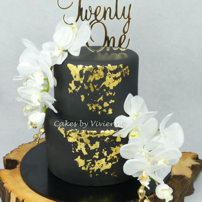 Black And Gold 21St Birthday Cake 6 and 9 inch chocolate mud cakes with black fondant, edible gold leaf and silk orchids (requested by client)