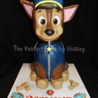 3-D Chase From Paw Patrol Cake Body is all cake, head is rice krispie treats. Covered in ganache, then covered in fondant and modelling chocolate.