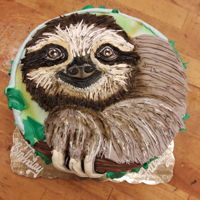 Buttercream Piped Sloth Cake 8 inch round marble cake decorated with buttercream and airbrush.