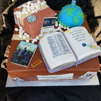 Congregation Relocation Cake With Edible Bible And Globe Everything is edible except the boards the cake sits on. Used edible images for the package labels and the book covers. Carved the Bible...