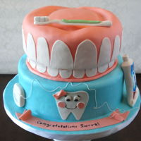 Dental Cake Celebration cake for a Dental Hygienist's graduation.Sculpted eight-to-nine inch round and ten inch round in fondant with fondant and...