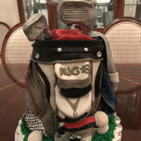 Golf Bag Groom's Cake This is a cake replica of the groom's golf bag. It is made of 7 stacked six inch rounds, covered in buttercream and fondant...