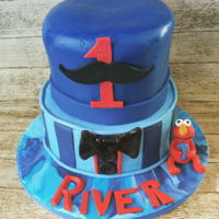 Happy Birthday River Grandsons Llttle Man 1st birthday cake. Included a mini Elmo, my grandsons fav guy. Had horrendous issues with heat & humidity, and my...