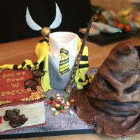 Harry Potter Cake The uniform was carrot cake, the book was vanilla, SMB and jam and the sorting hat was chocolate fudge with whipped chocolate ganache,...
