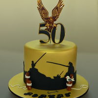 Hawks Football Club Fan & Fisherman's 50Th Birthday Cake Hazelnut mud cake filled with hazelnut ganache and iced and decorated with fondant.
