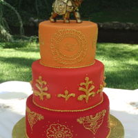 Indian Wedding Cake Six, eight, and ten inch rounds in fondant with Henna-style piping.
