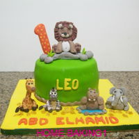 Leo Cake vanilla cake filled with raspberry filling, covered in fondant. figures are fondant with CMC