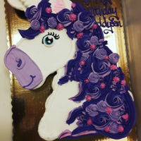 Purple Unicorn Cupcake Cake 24 cupcakes decorated with whipped icing for a girl who loves purple