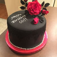 "Red Rose Birthday Cake This is a 5 1/2"" cake with black fondant and black lace. The rose is made from gumpaste."