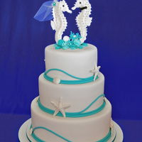 Seahorse Wedding Cake Perfect for a beachside wedding. Chocolate mud cake, caramel mud cake and white chocolate mud cake combination. Iced with fondant with gum...