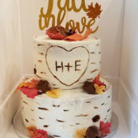 Autumn Leaves Bridal Shower Cake Two tiered cake for a bridal shower. I used their invitation as inspiration for the birch bark and carved initials. Leaves are made of...