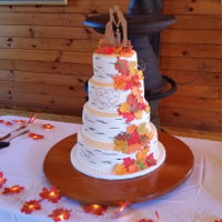 Autumn Wedding Cake Birch bark style wedding cake with cascade of autumn leaves
