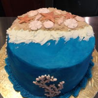 Beach Scene Beach scene cake with surf, sand, water, and shells. Banana cake and filling with vanilla buttercream. White chocolate shells.