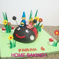 Ben And Holly chocolate cake covered in fondant, figures are gum paste
