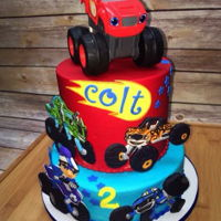 Blaze And Monster Machines Birthday Cake Buttercream cake with toy topper and fondant decor.