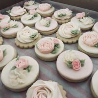 Blushing Buttercream Flower Cookies Sugar cookies decorated in all buttercream to celebrate a blushing baby girl! These beauties accompanied a double barrel naked cake.
