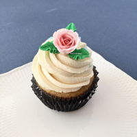 Cupcake With Floral Topper | Sweet Prodigy All buttercream vanilla cupcake with royal icing rose topper