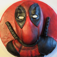 Deadpool Death by chocolate cake with buttercream frosting covered in fondant.