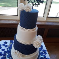 Double Sided Minion Wedding Cake Minions to the back, Royal Blue and White them with white roses to the front