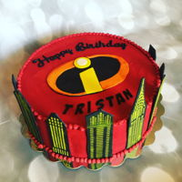 Incredibles Cake red buttercream with fondant decorations