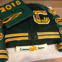 Letterman's Jacket Graduation Cake Graduation cake as replica of letterman's jacket. Chocolate cookie dough cake covered in ganache and fondant. Rice krispie treats...