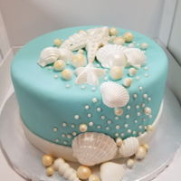 Seashell Cake Cake covered in fondant with seashells made with candy melts