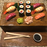 Sushi Rolls And Nigiri All edible other than the cake board!;-)