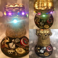 The Gauntlet From Infinity Wars All hand made and edible parts excluding the lights inside the infinity stones. Such a fun cake to make. Very challenging but fun!