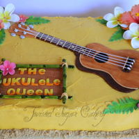 Ukulele Buttercream covered with fondant decorations and gumpaste flowers.