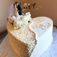 Wedding Cake Cornelli lace pipped heart shaped wedding cake. All vanilla !