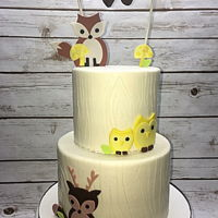 Woodland Cake Buttercream wood grain with fondant critters.
