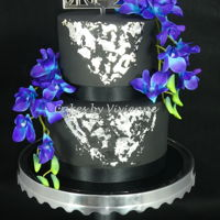 Black And Silver Orchid Cake 6 and 9 inch white chocolate mud cakes with silver leaf and silk orchids