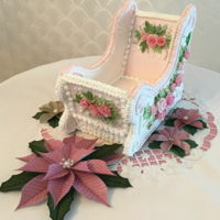 Christmas Gingerbread Sleigh Gingerbread, royal icing, fondant roses, pink pearl dust, assorted dragees