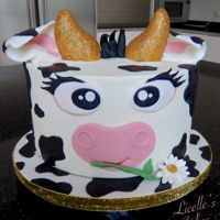 Cute Cow Cake Cute Cow Marble cake in buttercream with fondant decorations. The horns are rice bubble treats covered in fondant and painted gold.
