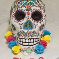Day Of The Dead Skull Cake Chocolate cake carved into a skull shape. Hand drawn patterns using edible markers.