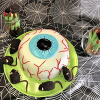 Eyeball Cake, Mice And Witch Fingers Cake is red velvet mice are chocolate and witch fingers are chocolate pretzles with almond nut nail