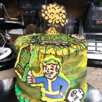 Fallout Game Cake Buttercream and Candy Melts. Multi color inside.Attempted a Game controller...kind of uneven...but he liked it.