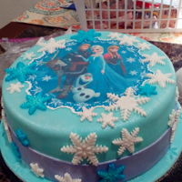 Frozen Cake Anna, Elsa and the crew. Colored vanilla cake, teal and purple with a strawberry filling. Covered in fondant & edible sheet.