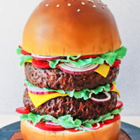 Giant Burger Cake Had sooo much fun creating this yummy one! It's all edible and every patty and bun is a separate layer with cake board, much...
