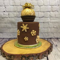 Giant Ferrera Rocher Chocolate cake with Nutella buttercream covered in chocolate ganache.