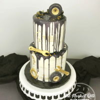 Gold & Black Semi-Naked Mechanic Cake Two-tiers of lemon cake and vanilla buttercream - decorated to match the clients cake topper for their dads surprise 60th birthday party!